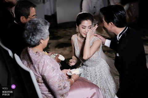 Bride getting emotional during the wedding in front of her parents in Bangkok