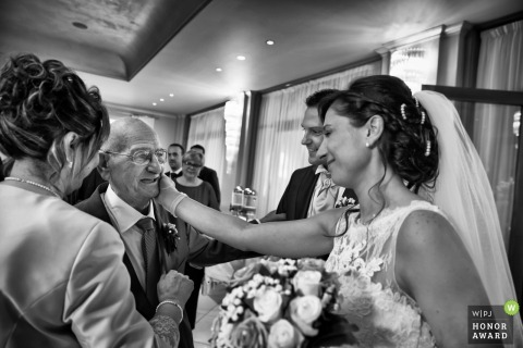 Father smiles as he sees his daughter in her dress | Ancona Wedding Photography