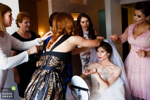 Romania bride getting her dress ready with her bridesmaids - Slatina wedding photography