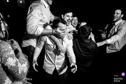 Groom and the groomsmen having fun with each other at the wedding reception in Rosario, Argentina