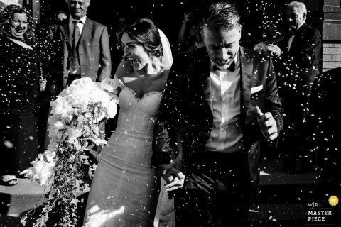 St. George Greek Orthodox Church - The bride and groom are showered with rice as they exit the ceremony in Lynn Massachusetts