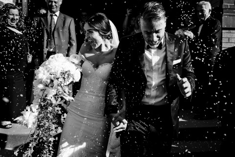 St. George Greek Orthodox Church - The bride and groom are showered with rice as they exit the ceremony