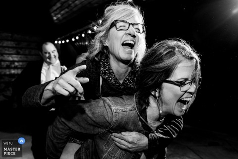 Women guests dance and laugh at the wedding reception in Hamilton, Montana