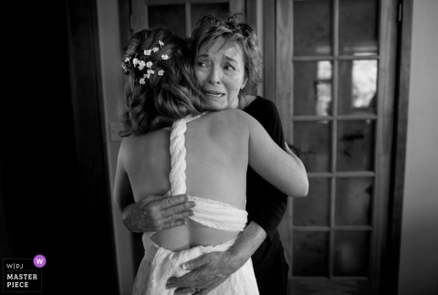 Bride hugs her mother as she gets emotional before the wedding ceremony in Flagstaff, Arizona