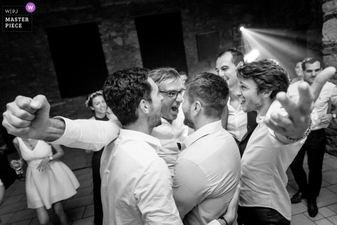Groom and groomsmen hug after the wedding ceremony in Nantes