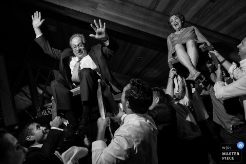 Parents of bride during the hora chair dance - Lake Tahoe Wedding Photographers