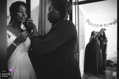 Paris bridesmaids take a selfie while the bride finishes getting ready before the wedding ceremony