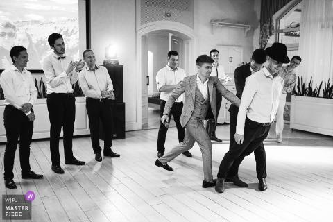 Groom and groomsmen dancing and having fun before the wedding ceremony in Kiev, Ukraine