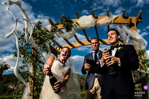 Camp Hale Wedding ceremony Champagne blast shot | Vail Wedding | Colorado Wedding Photographer