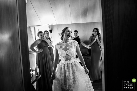 Ubeda bridesmaids admiring the brides dress