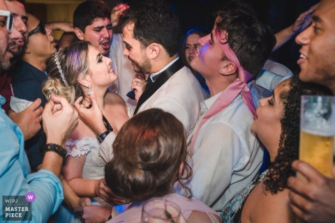 Bride and groom party with the guests at the wedding reception in Rio de Janeiro, Brazil