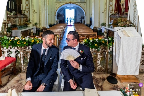 Sicilia groom and best man sit together before the wedding ceremony