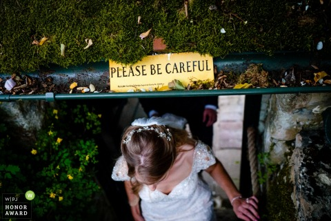 Boughton Monchelsea Place, UK - low overhead clearance as the bride emerges