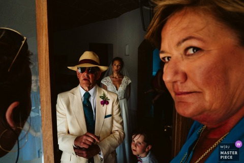 Bride with her parents before the wedding ceremony in mallorca, Spain