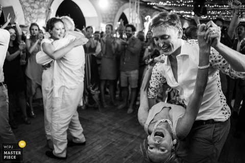 Bride and groom smiles as they dance at the wedding reception in mallorca, Spain