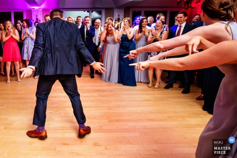 crowd goes wild for guest dancing at rock island lake club wedding reception