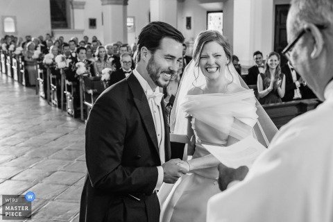 Malaga bride and groom laugh during the wedding ceremony