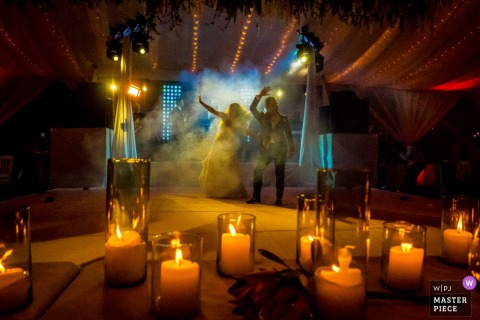 Photo of the bride and groom dancing in the lights at the wedding reception in san miguel, mexico