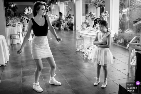 Flower girl dances with girl at the wedding reception in Viana do Castelo - Portugal