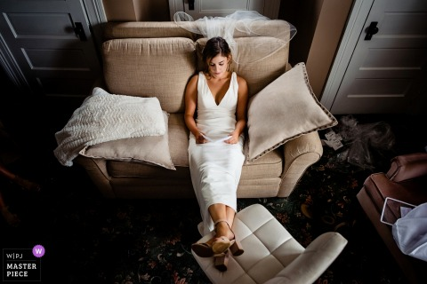 Bride sits in her dress before the wedding ceremony in Providence, Rhode island