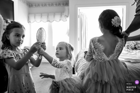Flower girls getting ready before the wedding ceremony in San Diego, California