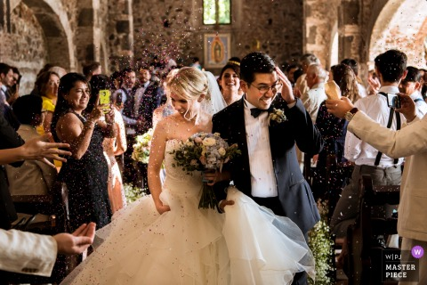 Guests throw rice at the bride and groom after the wedding ceremony in Mexico - Mexico-City