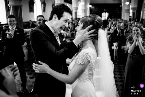 Bride and groom smile at each other during the wedding ceremony in Cork, Ireland