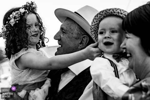 Dublin guests hold kids outside at the wedding