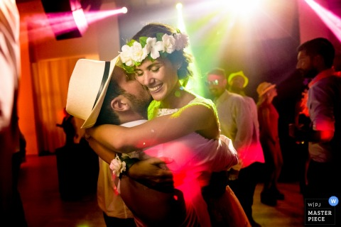 Groom kisses bride as they dance at the wedding reception in Rosario, Argentina