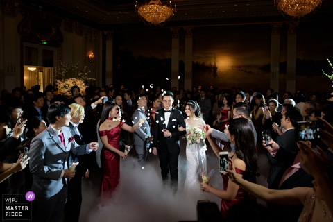 Guests congratulate and take photos of the bride and groom at the wedding in Bangkok