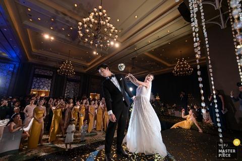 Bangkok bride and groom having fun at the wedding reception