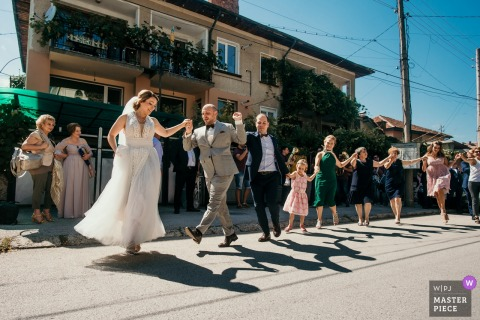 Bridal party dances outside on the street after the wedding in Sofia, Bulgaria