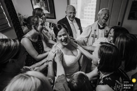 Guests laugh with the bride at the wedding in Bulverde, Texas