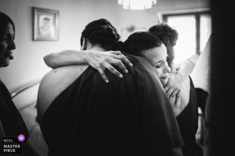 Bride hugs guests after the wedding ceremony in Spoleto - Il Baio