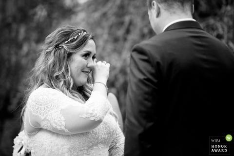 Bride sheds a tear during her wedding ceremony - Meyers Castle Wedding Ceremony