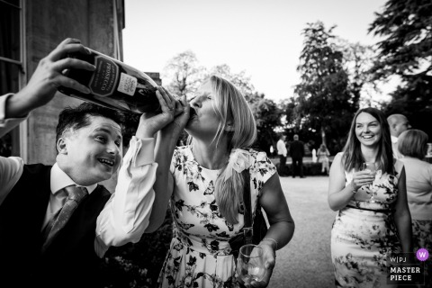 Guest enjoying a drink outside at the wedding reception