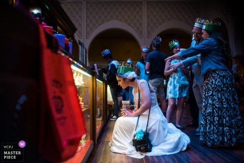 Bride in her wedding dress wearing a crown in Buena Vista, CA at Medieval Times