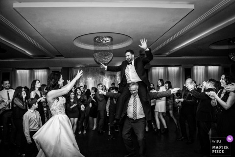 Bride and groom having fun at the wedding reception with guests in Montreal, Quebec