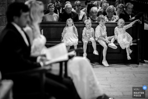 Oldenzaal kids sit on the bench during the wedding ceremony