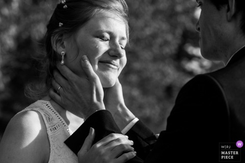 Bride gets emotional as the groom holds her during the wedding ceremony at the Glacier National Park, Montana