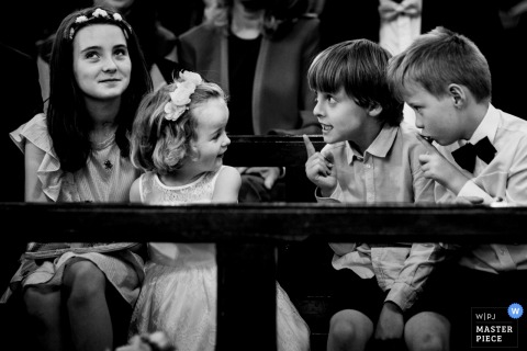 Kids talk to each other during the church wedding ceremony in Kilkenny, Ireland