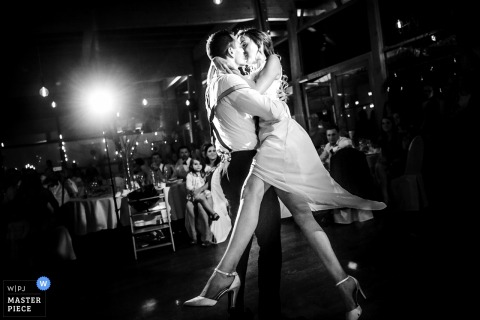 Bride and groom kiss while dancing at the wedding reception in Gründau