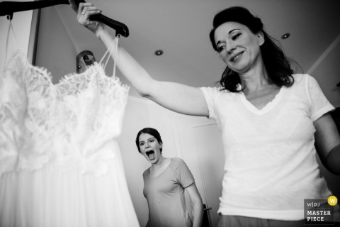 Bride holds her wedding dress before the ceremony in Schloss Ravensburg
