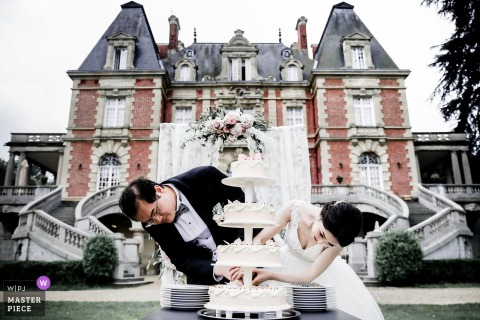Paris bride and groom outside with the wedding cake at the wedding reception
