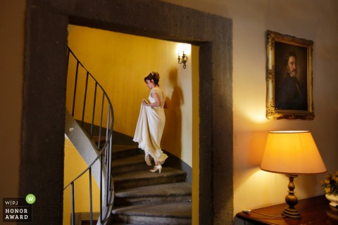 Bride walking up the stairs in her wedding dress | Reggio Calabria Wedding Photography