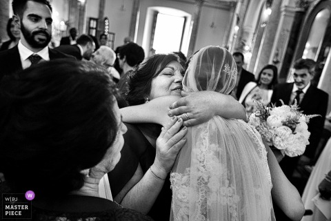 Calabria bride hugs guests after the wedding ceremony