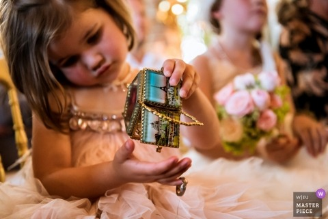 Little girl holds the wedding ring box at the wedding in Oisterwijk - The Netherlands