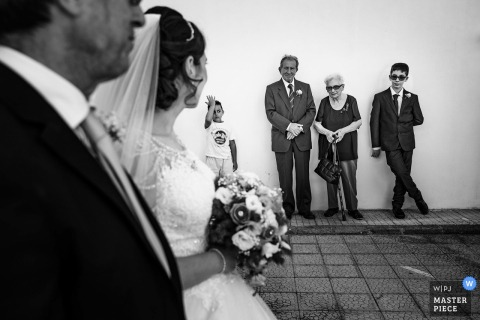 Calabria guests watch the bride and her father before the wedding ceremony