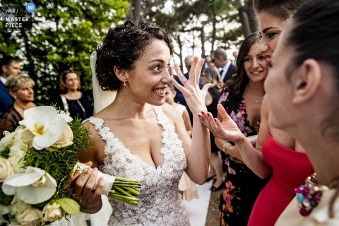 Calabria bride shows off the wedding ring to guests after the ceremony