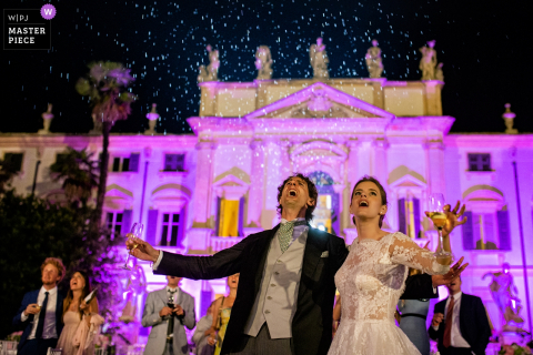 Bride and groom smile at the wedding reception outside at the Villa Mosconi Bertani - Veneto - Italy